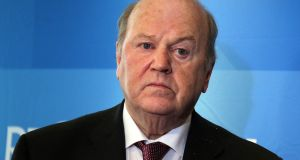 Fine Gael members of  committee believe  wording of  final report implies wrongdoing on  part of Minister for Finance Michael Noonan. Photograph: Niall Carson/PA Wire