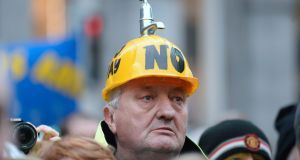 A demonstrator at a anti-water charges protest last year. Paul Murphy TD said: 'We have enough evidence to decide to get rid of water charges once and for all.' Photograph: Caroline Quinn/AFP/Getty Images