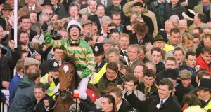 Istabraq and Charlie Swan are led back after winning their third  Champion Hurdle in a row in 2000. Photograph: Healy Racing