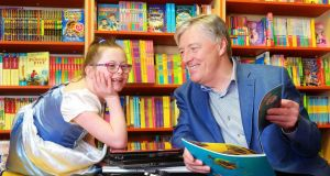 Ruthanne Gallagher (9) and Pat Kenny launch the Bring a Book, Buy a Book campaign in aid of St. Michael's House  during World Book Week, which  encouraged parents to go Tech-No for the week, and instead swap and read used books. Photograph: Marc O'Sullivan