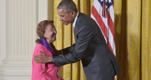 US president Barack Obama presents the 2014 National Medal of Arts to actress, director, theatre founder, Miriam Colón. Photograph:  Mandel Ngan/AFP/Getty Images