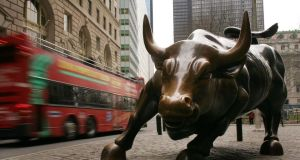The Wall Street bull: What if this current bull market isn't as old as it looks.  Photograph:  Spencer Platt/Getty Images