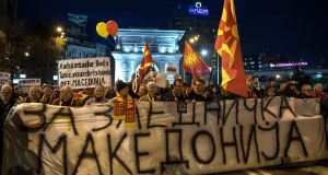 Supporters of the Civil Initiative for United Macedonia carry a  banner saying 'For united Macedonia' at a protest in Skopje. Photograph: Georgi Licovski/EPA