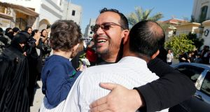 Paediatric surgeon Ali Al-Ekri  greets family members on his release from  prison in Manama, Bahrain, after five years.    He strongly criticised the military's excessive use of force against protesters in 2011. Photograph: Hamad I Mohammed/Reuters