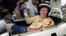 Former Formula One world champion John Surtees gives the thumbs up from the cockpit of his 1965 Honda at the Suzuka race track, Japan, in 2004.  Photograph: Oliver Multhaup /EPA