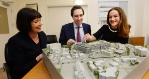 Minister for Health Simon Harris, St Vincent's  chief operations officer Kay Connolly and Dr Rhona Mahony, master of the National Maternity Hospital, with the model of the Natonal Maternity Hospital at St Vincent's. Photograph:  Cyril Byrne