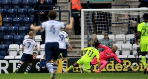 Daryl Horgan scores Preston North End's second goal during the Championship match against Reading at Deepdale. Photograph: Clint Hughes/PA Wire