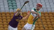 Wexford's Damien Reck blocks  Offaly's Oisin Kelly during the Allianz Hurling League Divison 1B match at  O'Connor Park in Tullamore. Photograph: Lorraine O'Sullivan/Inpho