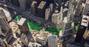 The Chicago river was dyed green on Saturday. Tourism Ireland hopes up to 300 landmarks in 40 countries will go green this year. Photograph: Lee Hogan/Chicago Sun-Times via AP
