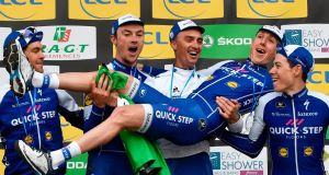 Ireland's Dan Martin  is carried by his Quick-Step Floors team-mates  Jack Bauer, Yves Lampaert,  Julian Alaphilippe  and  David De la Cruz  as they celebrate their best team award at the end of Paris-Nice. Photograph: Philippe Lopez/AFP/Getty Images