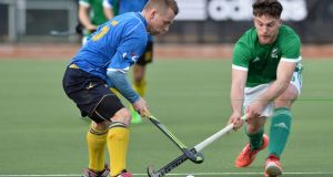 Mykhailo Yasinskyi and Jeremy Duncan clash during Ireland's 9-2 defeat of Ukraine in the Hockey World League Round 2 in Stormont in  Belfast. Photograph: Rowland White/Presseye/Inpho