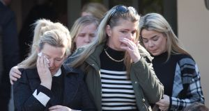 Mourners at the prayer service in Bray for Annmarie, Paris, AJ, Holly and Jordan O'Brien, who died in the Clondalkin fire. Photograph: Gareth Chaney Collins