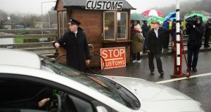 John McNamee, dressed as a customs worker, joined  members of Border Communities Against Brexit to protest against Brexit by setting up an old customs post at Carrickcarnon in February 2017. Photograph: Dara Mac Dónaill