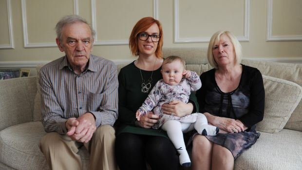 Lorraine Carthy with her daughter Tess aged 9 months and her parents Aidan and Phylis Carthy, in their home in Sandyford, Dublin. Photograph: Aidan Crawley
