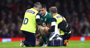 Ireland's Conor Murray gets treatment on his shoulder during the defeat in Cardiff on Friday. Photograph: James Crombie/Inpho