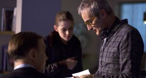 Director Olivier Assayas and Kristen Stweart on the set of  Personal Shopper