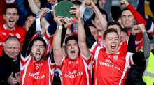 Oisín Gough, David Treacy and Paul Schutte lift the trophy after Cuala's  Leinster club final win over O'Loughlin Gaels at O'Moore Park, Portlaoise. Photograph: Ryan Byrne/Inpho