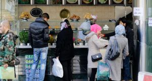 Syrians shop for fast-food in the capital Damascus. Photograph:  Louai Beshara/AFP/Getty Images