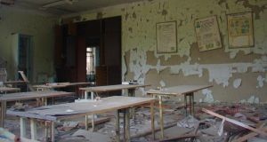 An abandoned classroom in Chernobyl is slowly succumbing to the advances of the natural world. Photograph: Stephen Starr
