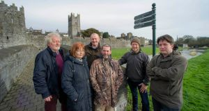 Concerned locals at the pedestrian bridge over the Clashawley river at Fethard, Co Tipperary, with the medieval town walls in the background. Photograph: L to R: Terry Cunningham (Fethard Historical Society), Mary Hanrahan (Fethard Historical Society), Kevin Collins (Birdwatch Ireland), Colm Hackett (Fethard & Killusty Anglers), Alan Moore and Vincent McCarthy