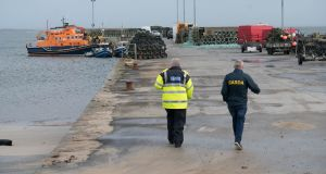 Gardai  at Blacksod Pier, Belmullet, Co Mayo. Photograph: Keith Heneghan/Phocus
