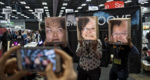 "Attendees wear cardboard ""faceboxes"" at the SXSW interactive festival in Austin. Photographer: David Paul Morris/Bloomberg"