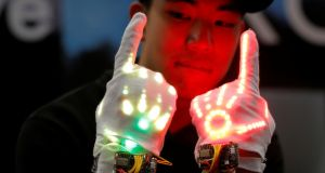"The Groove: This ""wearable glove device that enhances the dancer's expression"" is demonstrated at the SXSW festival 2017 in Austin, Texas. Photograph: Brian Snyder/Reuters"
