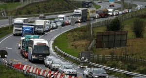 Traffic on the M1 from Dundalk into Newry, which will be slowed even further if Border crossings are re-established after Brexit. Photograph: Julien Behal/PA Wire