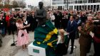Tony McCoy looks on with his family as  a statue of himself is unveiled during Champion Day of the Cheltenham Festival at Cheltenham. Photograph: Harry Trump/Getty Images