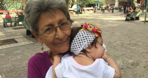 'My income is €8 a month because I'm retired,' says Daisy Perez Ramirez, a 72-year-old out walking with her great-granddaughter, Camila.