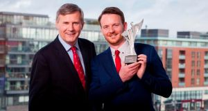 The 2016 winner of Leaders of Tomorrow, Vincent Forde, with Alastair Blair, managing director of Accenture