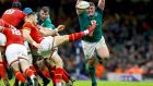 Ireland's  Tadhg Furlong attempts to block down a kick from Rhys Webb of Wales at the Principality Stadium in Cardiff. Photograph: James Crombie/Inpho