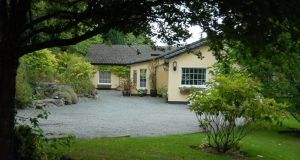 Mc Donnell Properties is seeking €950,000 for four-five-bedroom Ballard Lodge on 4.5 acres with paddocks and stables in Ashford, Co Wicklow