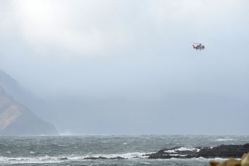 An aircraft sweeps the area for any sign of the three crew missing from the Irish Coast Guard Sikorsky S-92 helicopter which crashed off the north Mayo coast. Photograph: Dara Mac Dónaill