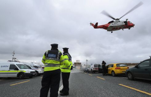 A Coast Guard helicopter arrives in Blacksod to refuel as the search continues. Photograph: Brian Lawless/PA