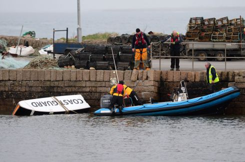Debris from the helicopter being taken to the pier in Blacksod, scene of the search for missing Coast Guard helicopter crew at Blacksod, Co. Mayo. Photograph: Dara Mac Donaill / The Irish Times  Photograph: Dara Mac D?naill / The Irish Times         Photograph: Dara Mac Donaill / The Irish Times