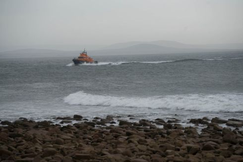 A lifeboat takes part in the search for a missing Coast Guard helicopter near Blacksod Lighthouse, Co Mayo on Tuesday morning. Photograph: Keith Heneghan/Phocus