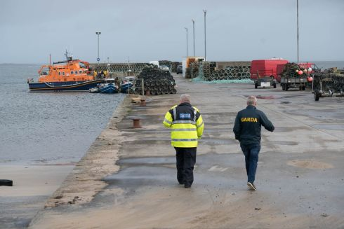 Gardai approach the Ballyglass lifeboat, which is changing crew to continue the search for the missing helicopter. Photograph: Keith Heneghan/Phocus