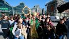 St Patrick surrounded by visiting Spanish students in Dublin in advance of the parade of Friday's parade. Photograph: Nick Bradshaw