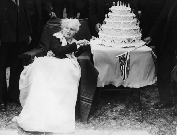 Irish-born American labour organiser Mother Jones (Mary Harris Jones) poses with a five-tiered cake in celebration of her 100th birthday in 1930. Photograph: FPG/Getty Images