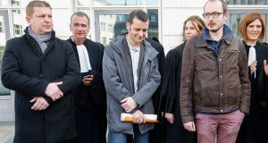 Raphael Halet (left), and Antoine Deltour (right), former employees of PricewaterhouseCoopers, and journalist Edouard Perrin (centre) pictured on Wednesday. Photograph: EPA