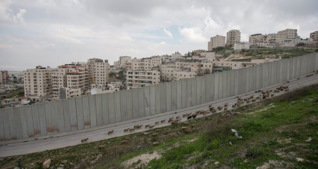 An Israeli wall separating the Palestinian refugee camp of Shuafat from an East Jerusalem neighbourhood. Israel and the US strongly rejected the UN report. Photograph: Atef Safadi/EPA