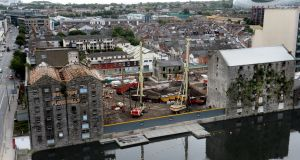 Bolands Mills roof restoration in progress and the overall site of Bolands Quay. Photograph: Cyril Byrne