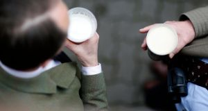 Racegoers enjoy a drink at Cheltenham racecourse. Photograph: Alan Crowhurst/Getty Images