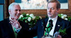 US vice president Mike Pence  listens while Taoiseach Enda Kenny speaks during a St Patrick's Day breakfast at the Naval Observatory. Photograph: Brendan Smialowski/AFP/Getty Images