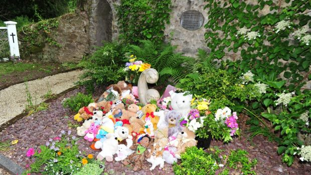 "Teddy bears and toys, which had been fixed on the railings, after being moved to the ""Little Angels"" plot in the graveyard at Bessborough House. Photograph: Michael Mac Sweeney/Provision"