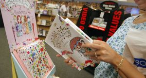 Kabbalistic? A customer looks at Madonna's  children's book The English Roses. Photograph: Tim Boyle/Getty