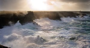 In evocative verse, the poet describes the sun setting off the west coast of Ireland as waves break and crash against cliffs