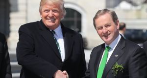 "The president meets the Taoiseach: Donald Trump and Enda Kenny after a ""Friends of Ireland"" lunch in Washington. Photograph: Niall Carson/PA Wire"