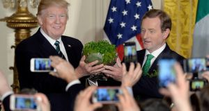 US President Donald J. Trump accepts a bowl of shamrock from Enda Kenny  at the White House. Photograph: EPA/Olivier Douliery